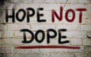 A graffiti on a wall saying